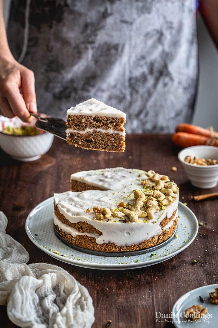 a woman serving a layer cake