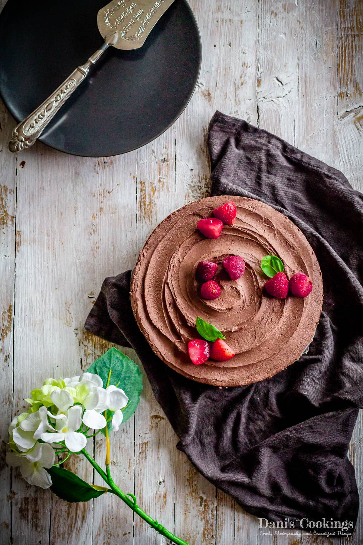 mousse cake with berries on a wooden background