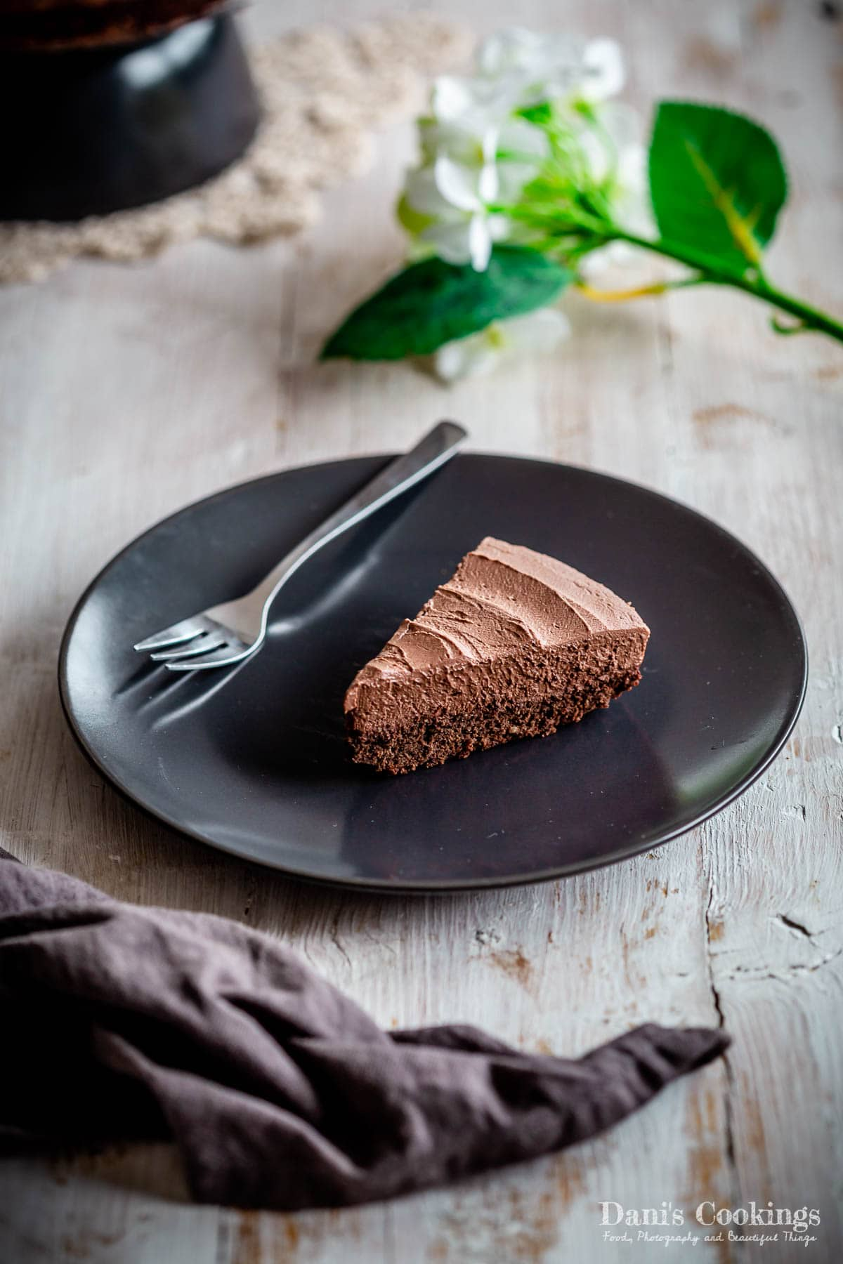 a slice of keto mousse cake on a black plate