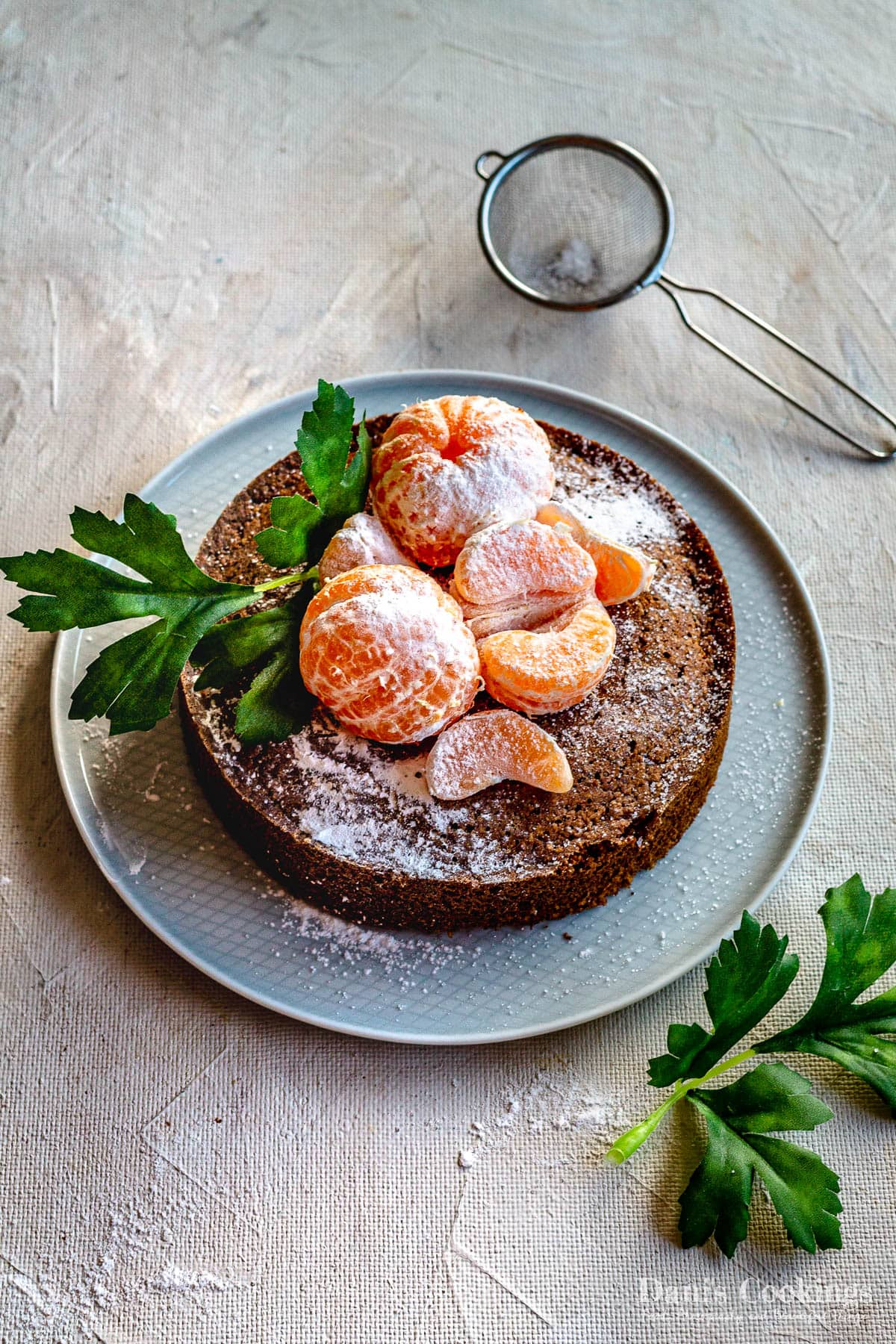 a simple cake with whole clementines on top and sprinkled with sugar