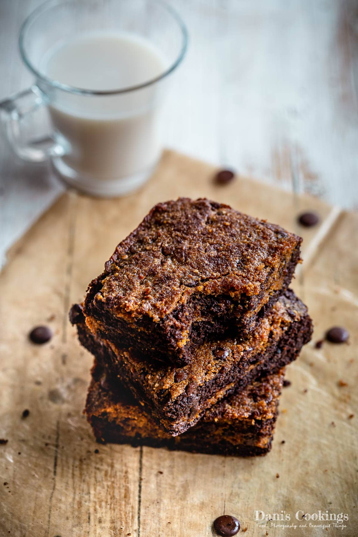 three stacked sweet potato brownies with a cup of milk aside