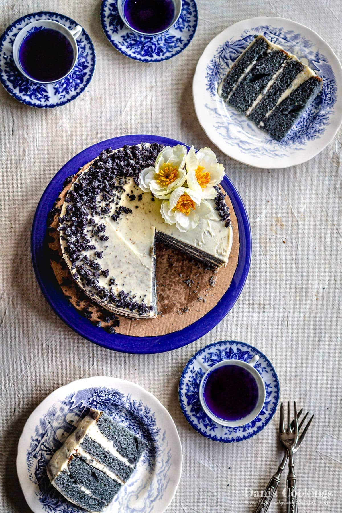 flat lay of a cut cake and blue layers aside