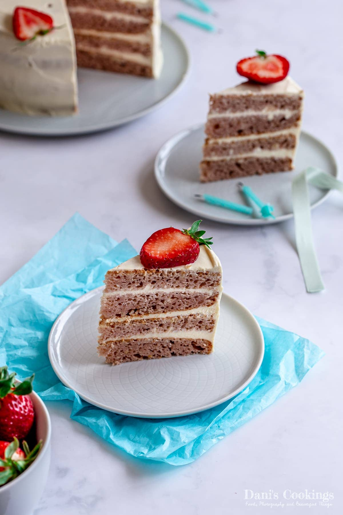 two slices of cake with strawberries