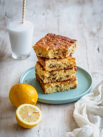 a stack of four blondies with milk and lemons aside