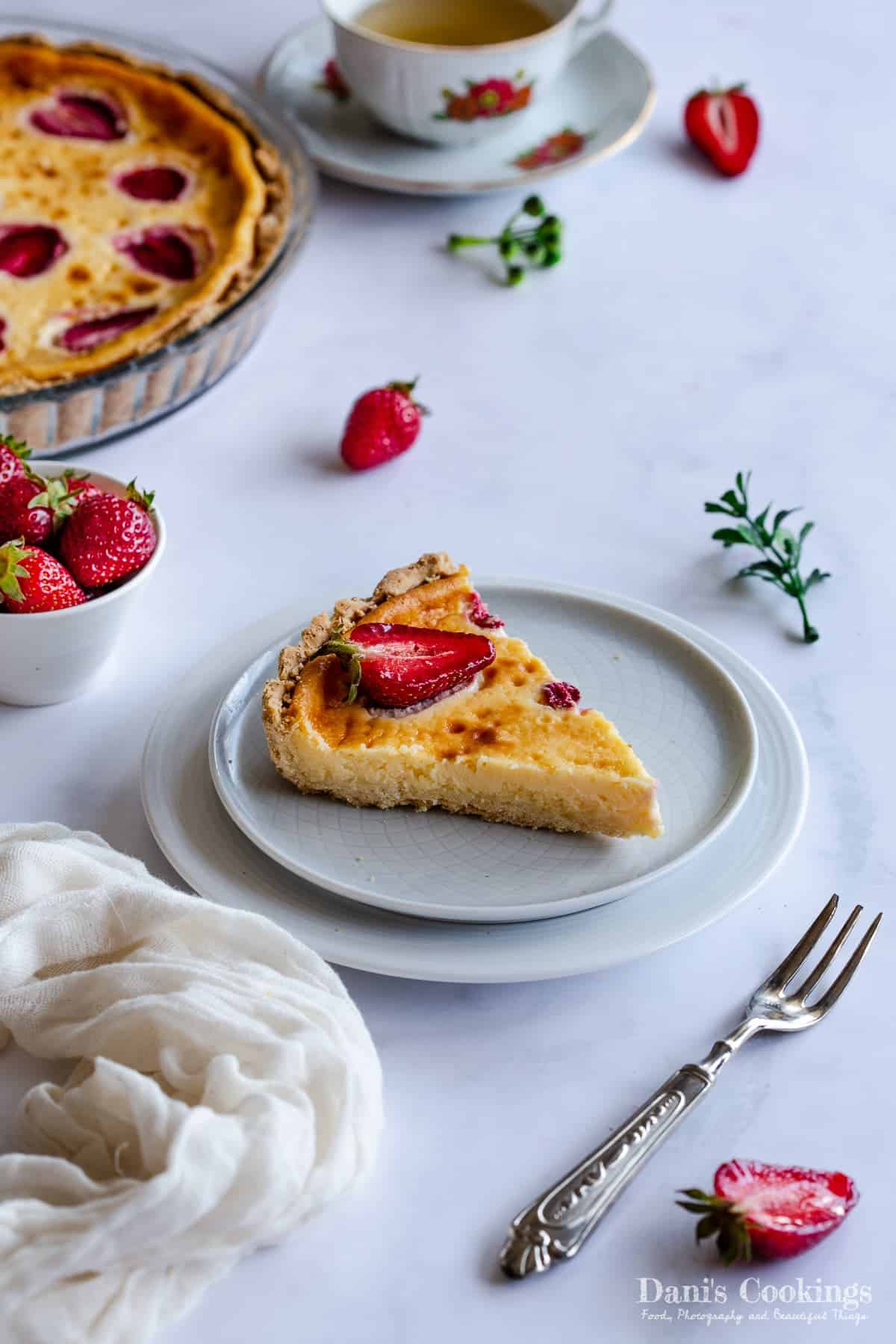a slice of tart with strawberries on top
