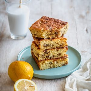 stacked blondie bars with lemons aside