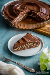 a slice of zebra cake in front of the pan