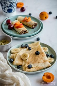 rolled and folded crepes with fruits and nuts