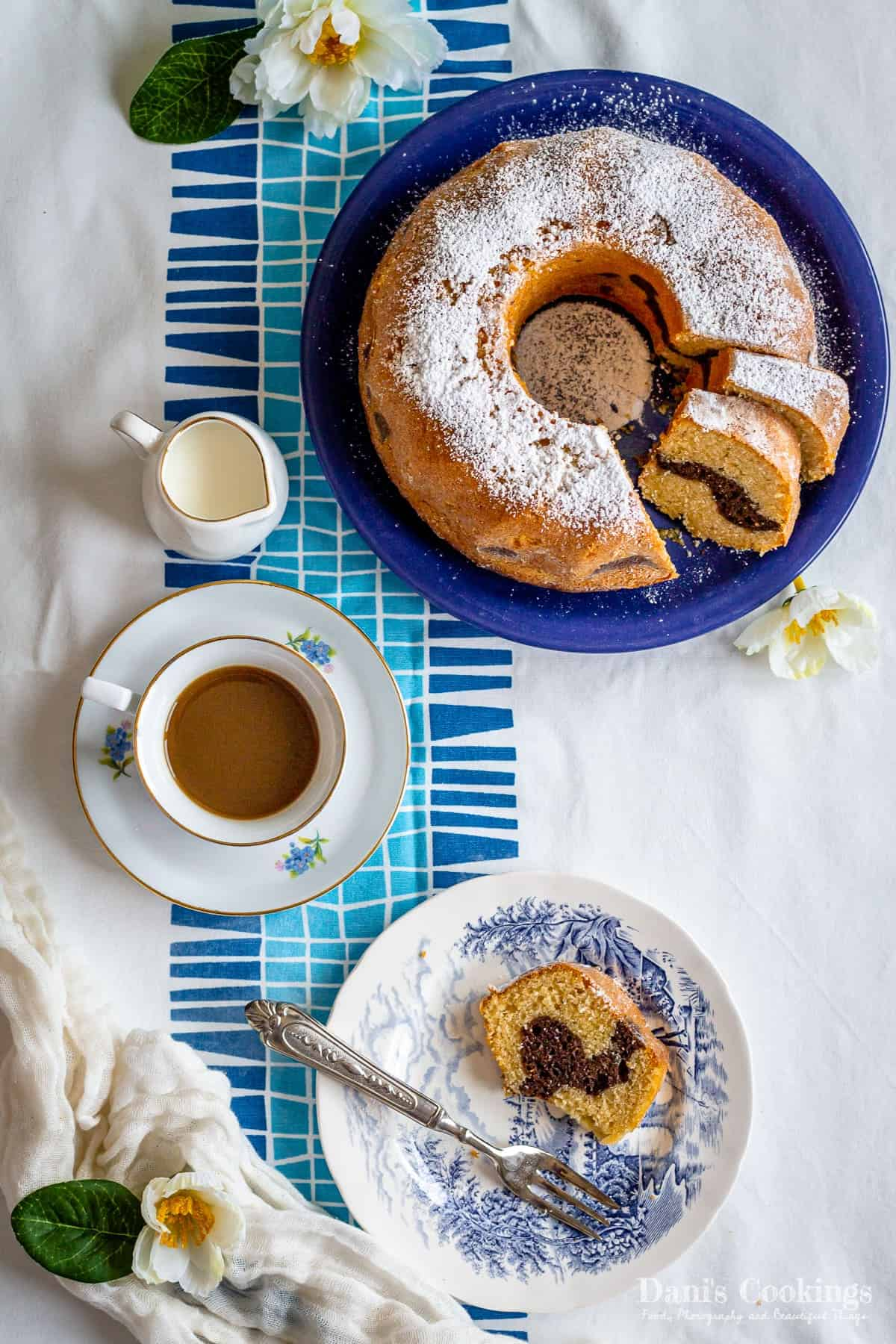 sliced bundt cake with a plate with one slice and coffee aside